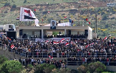 Druze living on the Israeli side of the Golan celebrate the Syrian independence day (photo credit: Hamad Almakat/Flash90)