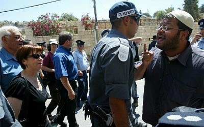 Meretz MK Zehava Gal-on walks in Hebron as right-wing activist Itamar Ben-Gvir shouts in an earlier confrontation in June 2008 (photo credit: Olivier Fitoussi/Flash90)