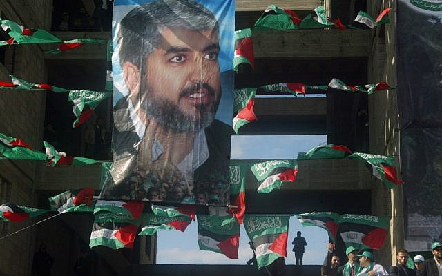 A poster of Hamas leader Khaled Mashaal on display during a 2008 rally in Gaza City. (photo credit: Abed Rahim Khatib/Flash90)