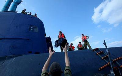 IDF naval soldiers board a Dolphin-class submarine in Haifa, September 2009 (photo credit: Moshe Shai/Flash 90)