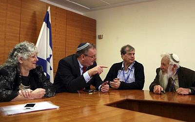 Minister of Science and Technology Daniel Hershkowitz (gesturing) in an unusual 2010 meeting with Israeli Nobel laureates of the past decade. Participating in the meeting were Aaron Ciechanover, Israel Aumann (right), Ada Yonath, and Peretz Levi (not seen). (photo credit: Gil Yohanan/Flash90)