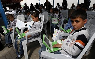 Palestinian students use new laptops at a UN school in Gaza (photo credit: Abed Rahim Khatib/Flash 90)