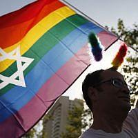 A marcher waves a Jewish Pride flag at Jerusalem's 2012 Gay Pride Parade. (Miriam Alster/FLASH90)