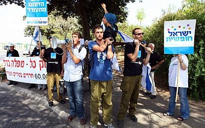 Dozens of reserve soldiers protesting against the Tal Law in front of the Knesset in 2011. (photo credit: Abir Sultan/Flash90)