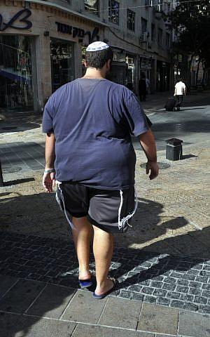 Overweight man walking on Ben Yehuda Street in Jerusalem (photo credit: Serge Attal/Flash 90)