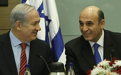 Prime Minister Benjamin Netanyahu with tKadima party head Shaul Mofaz (photo credit:  Miriam Alster/Flash90)