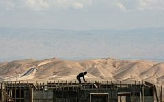 A worker at a construction site in the West Bank settlement of Maaleh Adumim in March 2011 (Kobi Gideon/Flash90)