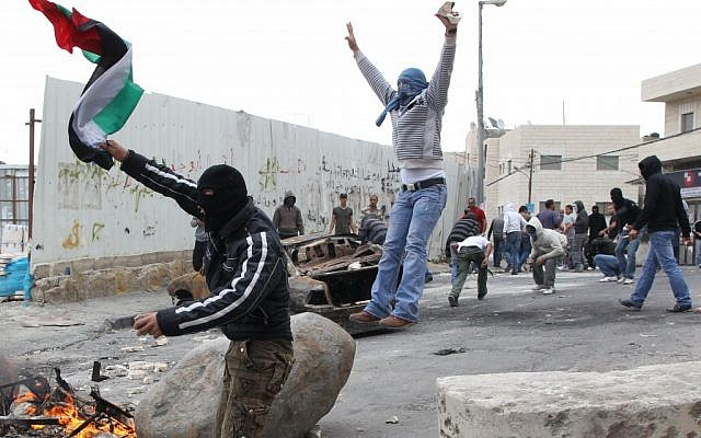 Stone throwing Palestinians clash with Israeli troops in East Jerusalem in 2011 (photo credit: Nati Shohat/Flash90)