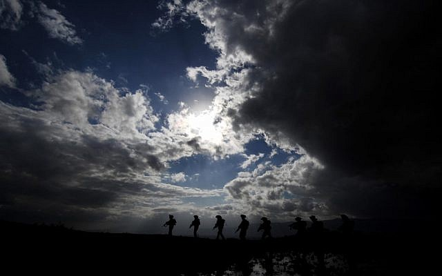 Golani soldiers during an exercise in the Golan Heights (photo credit: Abir Sultan/ Flash 90)