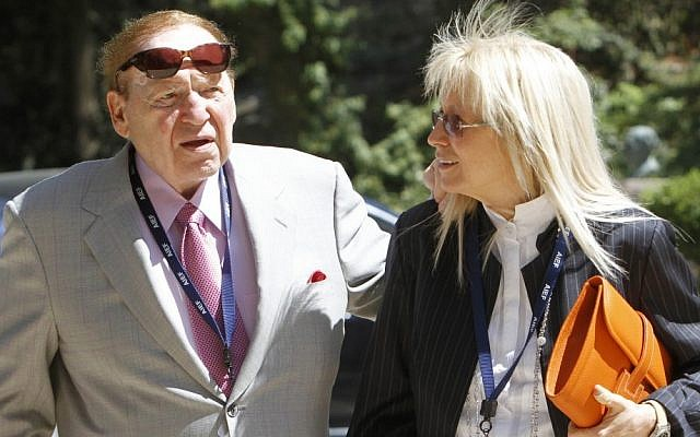 Businessman Sheldon Adelson, left, and his wife, Miriam, on a trip to Israel (photo credit: Miriam Alster/Flash90/File)