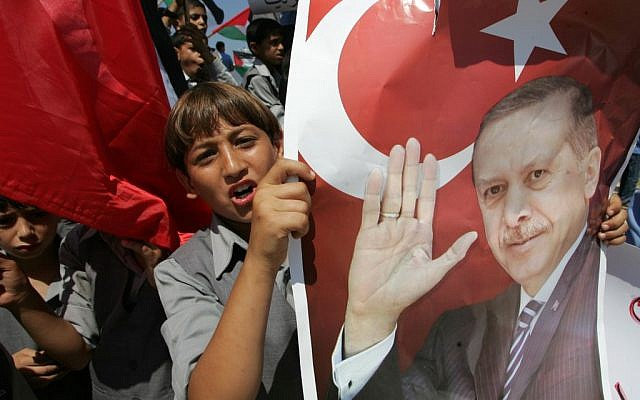 Palestinians hold pictures of Tayyip Erdogan in a Gaza protest (photo credit: Abed Rahim Khatib/Flash 90)