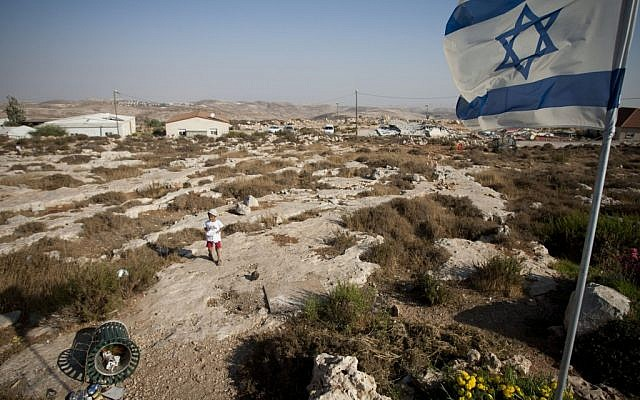 Young boy in the West Bank outpost of Migron (photo credit: Yonatan Sindel/Flash90)