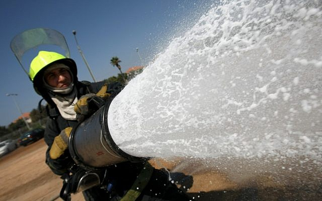 A new fire department recruit trains at a base in central Israel (photo credit: Kobi Gideon/Flash90)