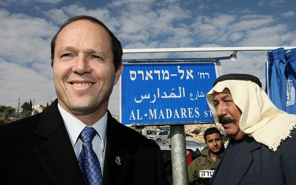 Then-Mayor Nir Barkat visits the East Jerusalem neighborhood of Issawiya to inaugurate a new road. (Kobi Gideon/Flash90)