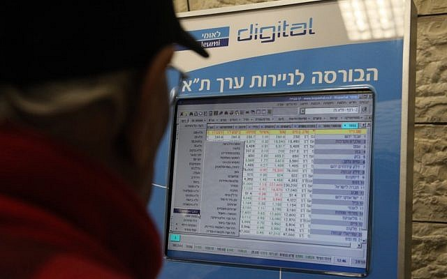 A man looks at screen listing prices of the Tel Aviv Stock Exchange (illustrative photo credit: Yossi Zamir/Flash 90)