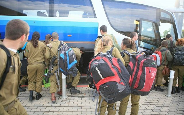IDF soldiers depart their base for weekend leave (photo credit: Yehoshua Yosef/Flash90)