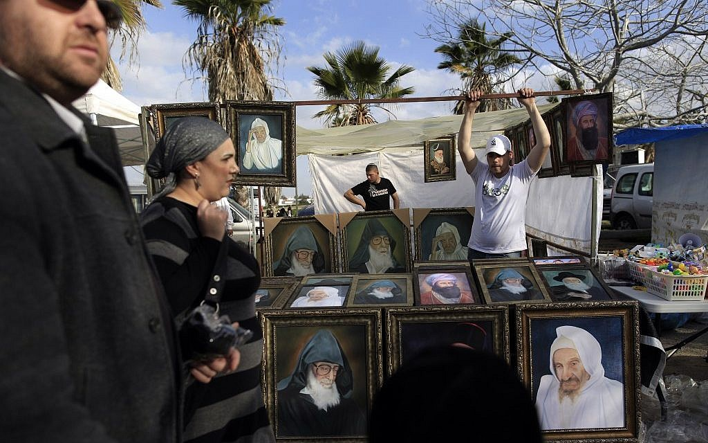 A vendor sells pictures during the annual pilgrimage to the tomb of Rabbi Abuhatzeira in 2012 (photo credit: Tsafrir Abayov/Flash90)