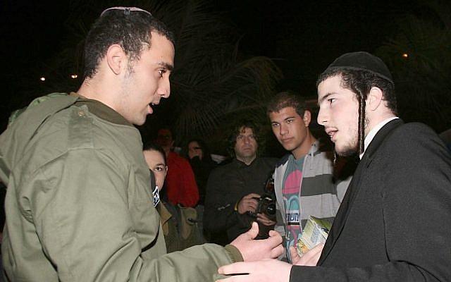 An Orthodox soldier and an ultra-Orthodox Israeli. (photo credit: Gideon Markowicz/Flash90)