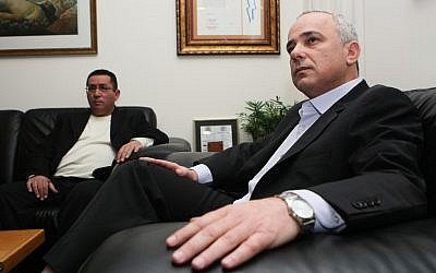 Finance Minister Yuval Steinitz, right, meeting with Histadrut head Ofer Eini Tuesday. (photo credit: Kobi Gideon / Flash90)