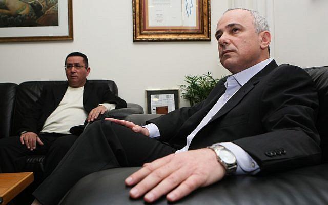 Finance Minister Yuval Steinitz, right, meeting with Histadrut head Ofer Eini Tuesday. (photo credit: Kobi Gideon / Flash90)