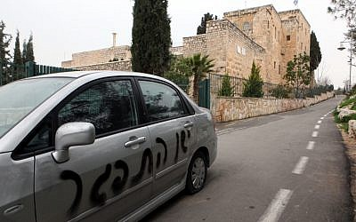 "Graffiti reading ""Price Tag"" and ""Death to Jesus"" seen spray-painted outside the Monastery of the Cross in Jerusalem. Feb 7, 2012.  (photo credit: Yossi Zamir/Flash 90)"