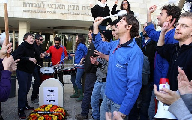 A demonstration outside the National Labor Court in Jerusalem Wednesday, with a gravestone reading 'the honor of the working man.' (photo credit: Nati Shohat/Flash90)