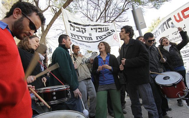 Demonstrators shout outside the National Labor Court in Jerusalem yesterday. (photo credit: Nati Shohat/Flash90)