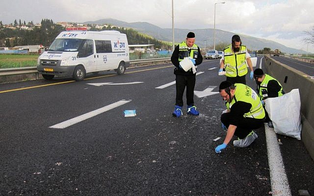 This photo supplied by Zaka shows members of the organization at the scene of a hit-and-run accident in northern Israel early Friday morning. (photo credit: Zaka / Flash90)