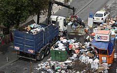 Jerusalem municipality workers clear garbage in the center of Jerusalem Sunday. (photo credit: Kobi Gideon/Flash90)