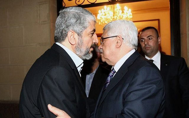Hamas leader Khaled Mashaal (left) meets with Palestinian Authority President Mahmoud Abbas in Cairo, February 23, 2012 (photo credit: Mohammed al-Hums/Flash90)