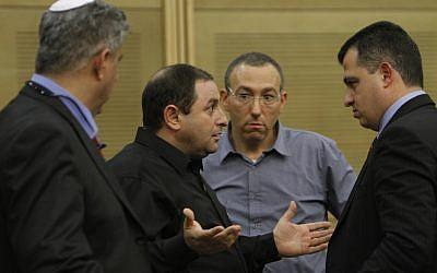 Factory owner Oshik Efraim (left) speaks to MK Carmel Shama Hacohen at the Knesset on Sunday (photo credit: Miriam Alster/Flash90)