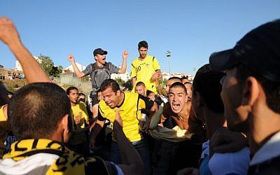 Fans of the Israeli soccer team Beitar Jerusalem (photo credit: Gili Yaari/Flash90)