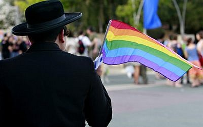 A woman dressed as an Ultra Orthodox man poses for a picture as she participates in the gay parade in 2008 in Jerusalem. (Photo Credit: Olivier Fitoussi /FLASH90)