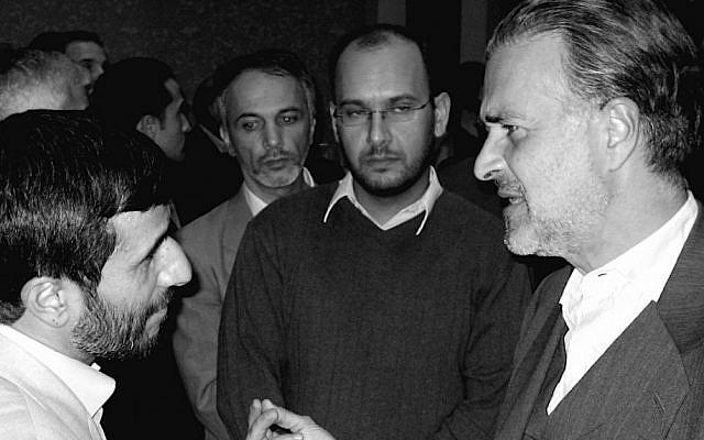 Hooman Majd with Mahmoud Ahmadinejad. (photo credit: Courtesy)