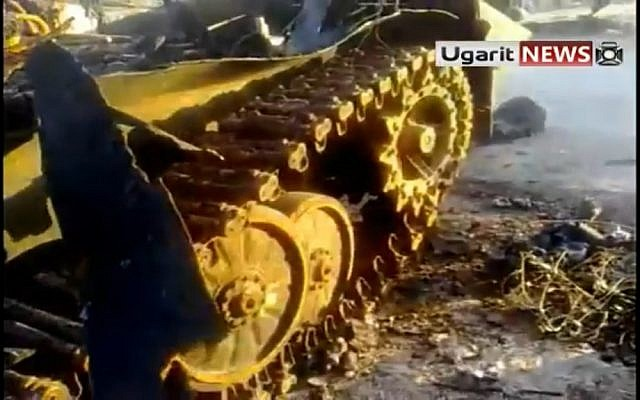 An army tank destroyed by the opposition in Idlib (photo credit: Ugarit News)