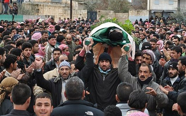 A funeral procession in Homs, February 7, 2012 (photo credit: AP)