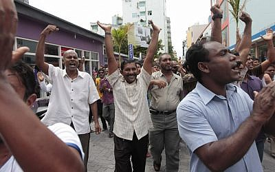 Supporters of former Maldivian president Mohamed Nasheed cheer after prayers in Male, Maldives, in February 2012. (photo credit: AP/Eranga Jayawardena)