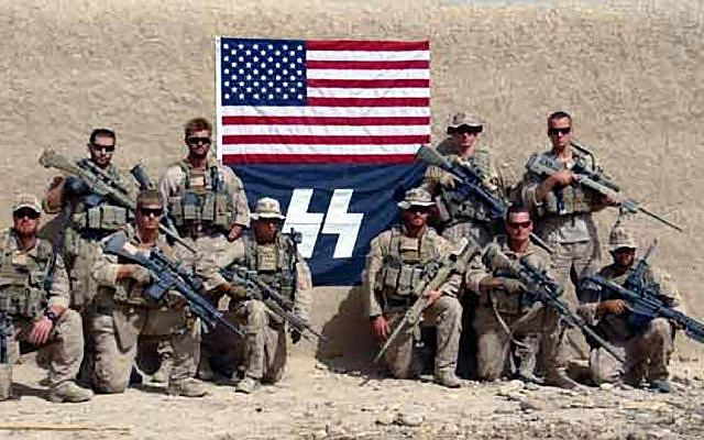 Illustrative: A Marine scout sniper battalion posing with US and Nazi flags, September 2010 (AP Photo/ knightarmco.com)