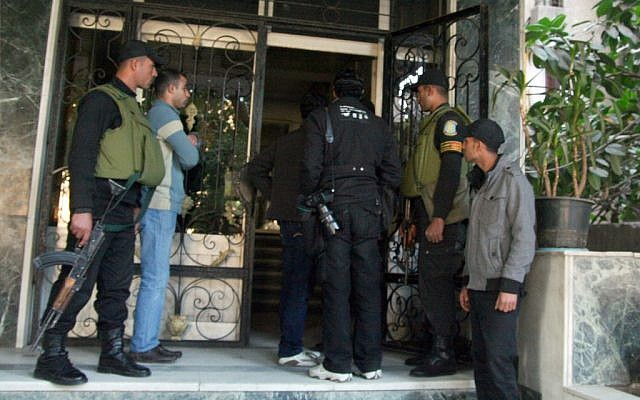 In this Thursday, Dec. 29, 2011 file photo, Egyptian military stand guard as officials raid one of the non-governmental organization offices in Cairo, Egypt (photo credit: AP Photo/Mohammed Asad)