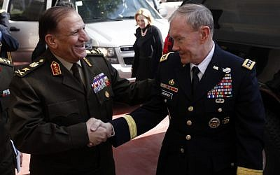 U.S. Chairman of the Joint Chiefs of Staff, Gen. Martin Dempsey, right, shakes hands with Lt. Gen. Sami Anan, left, upon his arrival to meet with Field Marshal Mohamed Hussein Tantawi, head of Egypt's ruling military council, at the Ministry of Defense in Cairo, Egypt, Saturday, Feb. 11, 2012. (photo credit: AP/Khalil Hamra, Pool)