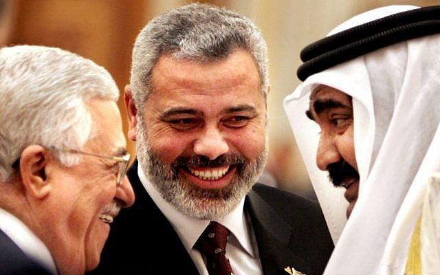 Palestinian Authority President Mahmoud Abbas, left, Hamas leader Ismail Haniyeh, center, and then-Qatari Emir Sheik Hamad bin Khalifa Al Thani  in Doha, Qatar, February 6, 2012. (AP/Amr Nabil)