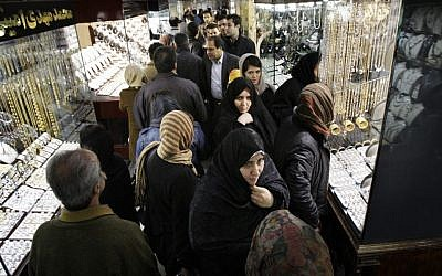 Iranians walk at the gold market of Tehran's old main bazaar. (photo credit: AP)