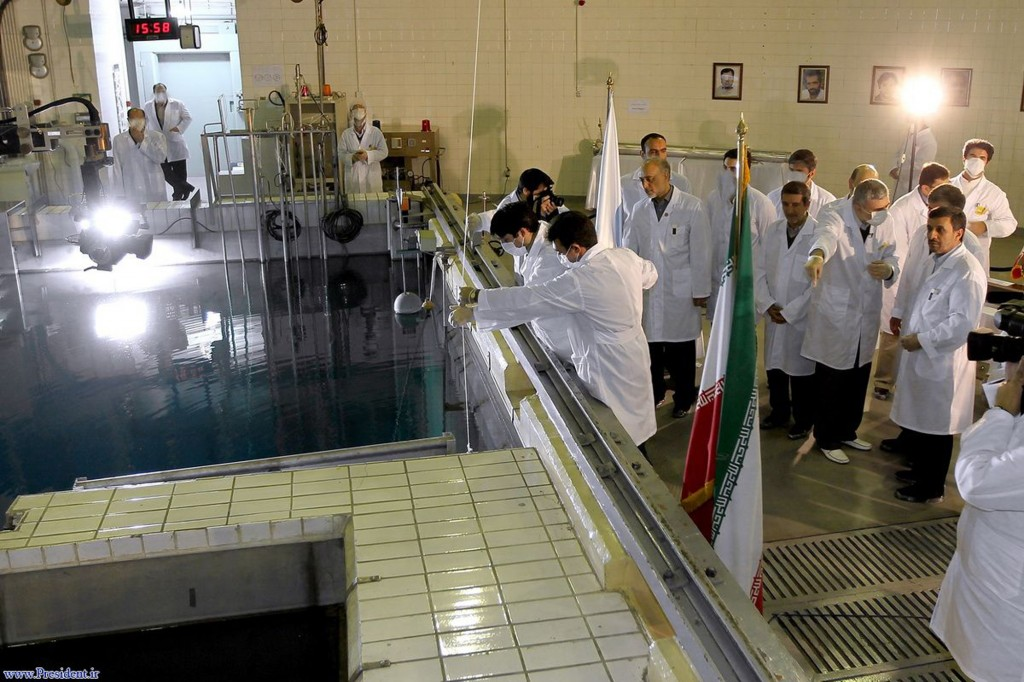 iranian president mahmoud ahmadinejad right is escorted by technicians during a tour of tehrans