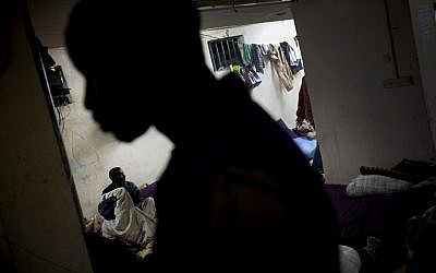 African migrants at a shelter in Tel Aviv (photo credit: AP/Oded Balilty)