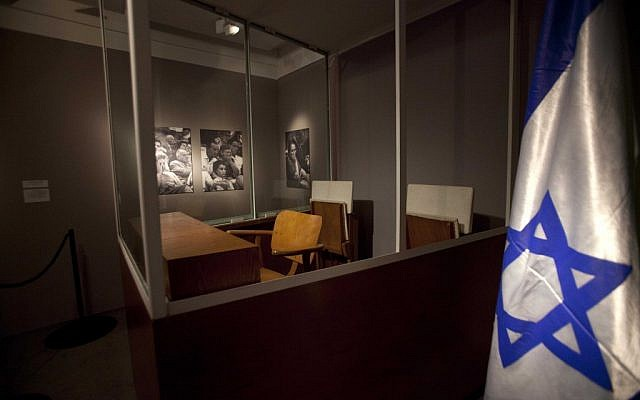 A wooden chair is placed inside a bullet-proof booth where Eichmann sat during his trial in 1961 (photo credit: AP/Dan Balilty)