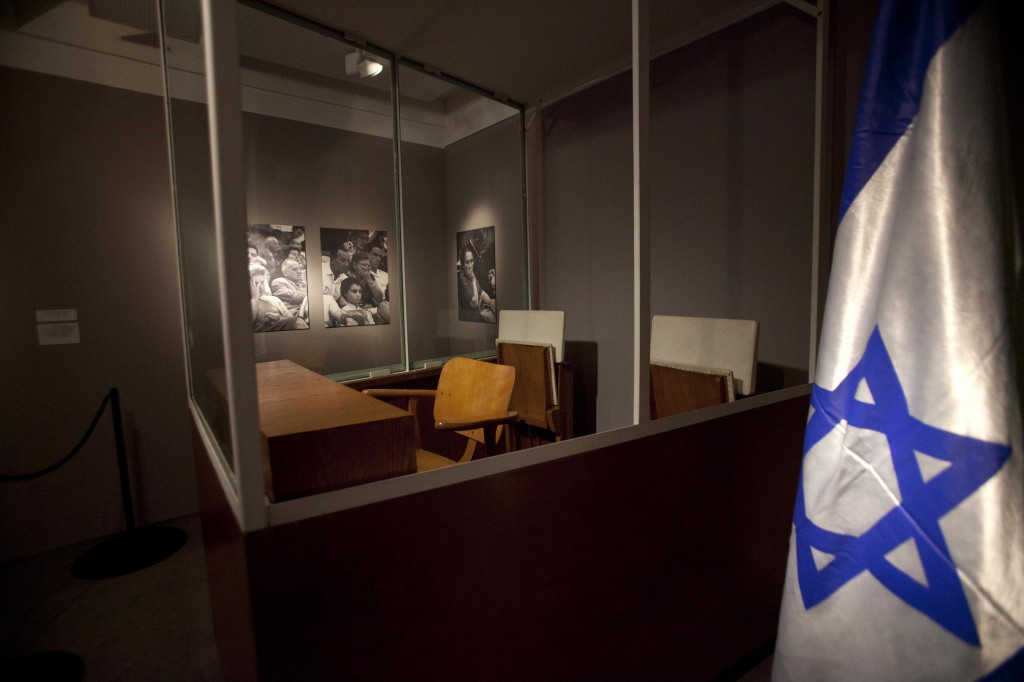 The booth where Eichmann sat as he stood trial in Jerusalem in 1961, on display. (photo credit: AP/Dan Balilty)