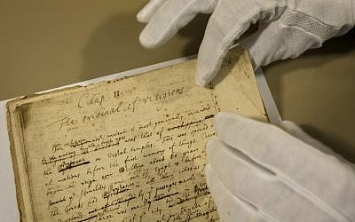 A page from influential scientist Sir Issac Newton's newly digitized theological collection, at the national library in Jerusalem. (photo credit: AP/Sebastian Scheiner)