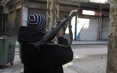 A man holds a rocket-propelled grenade launcher during clashes in Tripoli, Lebanon, Saturday, Feb. 11, 2012. (photo credit: AP)
