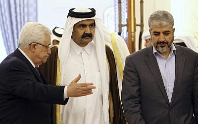 The Emir of Qatar Sheikh Hamad Bin Khalifa Al-Thani, center, Palestinian President Mahmoud Abbas, left, and Hamas leader Khaled Mashaal, right, arrive to sign an agreement in Doha, Qatar, February 6, 2012.  (AP/Osama Faisal, File)