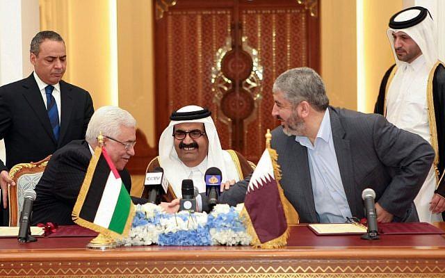 Palestinian President Mahmoud Abbas, left, shakes hands with Hamas leader Khaled Mashaal, right, as the Emir of Qatar, Sheikh Hamad bin Khalifa Al Thani, center, looks on Monday. (photo credit: AP/Osama Faisal)